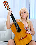 Hot blonde piano playing teenager rubs her slippery pussy