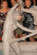 Hot chicks wrestling and pulling off clothes in a mud pit