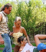 Large group of people having groupsex during outdoor BBQ