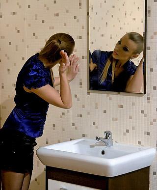 Two lesbian hotties sucking rubber pecker in a big toilet