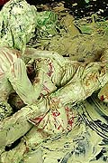 Two hot lesbian babes playing with their messy finger paints