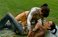 Lesbian porn stars kissing their soaked and dirty bodies