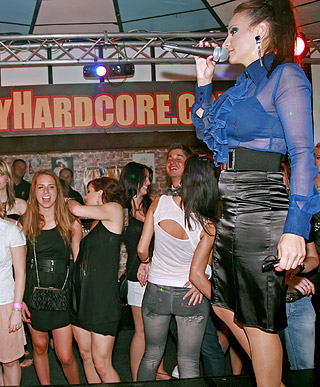 Clothed chicks playing with klarge stiff peckers at a club