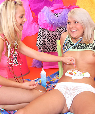 Two cute teenage lesbians playing with a pie and their pussy