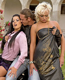 Two clothed pretty girls screwing very horny guy outside