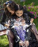 Two crazy hotties enjoy shagging in their massive garden