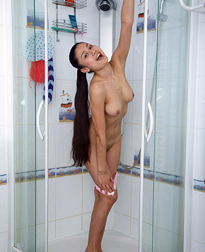 Showering beauty caresses herself with a drenched sponge