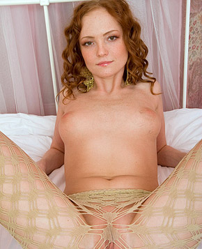 Pretty naked redhead masturbates her soaked tight pussy