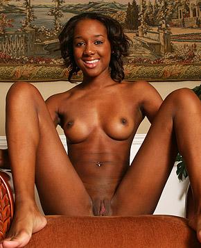 Gorgeous teenage ebony babe strokes her pretty nude body