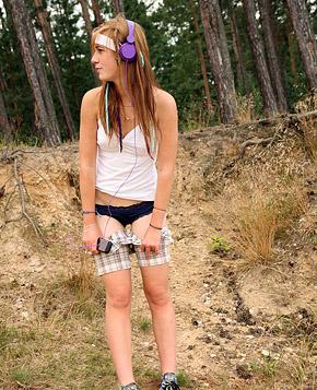 Cute daring teenage sweetie rubbing her wet pussy publicly