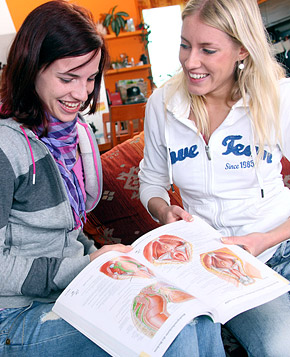 Lesbian blonde and brunette girls massaging their bodies