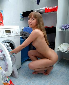 Cutie sitting on washing machine pleasuring her wet pussy
