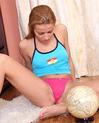 Teen sweetie caressing her damp coochie on floor carpet
