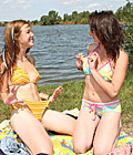Two very sexy lesbian teenage girls scissoring outdoors
