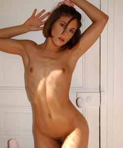 Adrianna masturbating in a sunny room