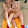 Pretty lesbian teenies get naked and naughty with dildos