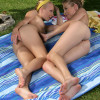 Sultry lesbians kiss and fist tight dripping twats outdoors