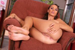 Stunning vixen drops panties and spreads twat in armchair