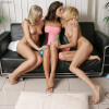 Three enticing teens lick and fist fresh pussies on couch
