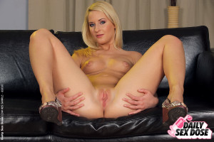 Sexy blonde gets round ass and fingering herself
