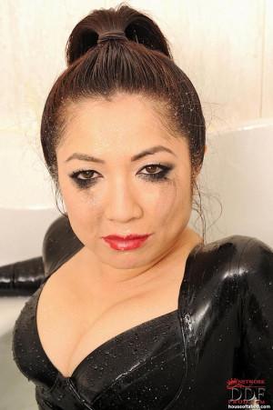 Hot Midori Tanaka dildoing in latex