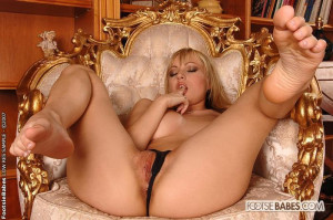 Busty Bianca fingering and licking her nice legs