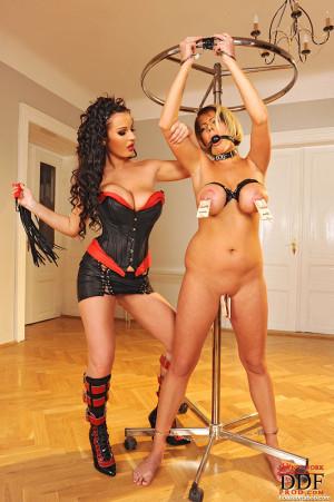 Hot Lola gets her big tits spanked
