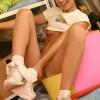 Cute teen gives a peek inside her panties of her pink lips