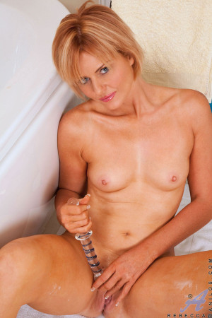Naughty cougar Rebecca spreads her ass wide open and strokes her pussy with her favorite dildo