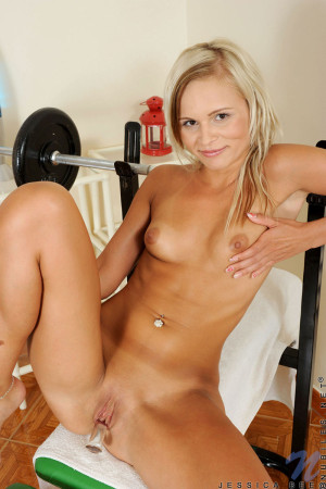 Sexy Nubile Jessica Bee on top of exercise bench fucks a tiny glass toy