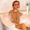 See katrina with her charming smile soaking her nude body on this bubbly bathtub