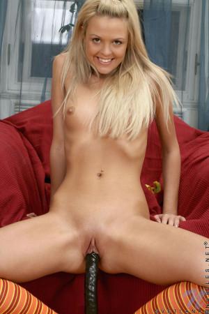 Blonde babe Svetlana stuffs a double headed dildo in her tender teen snatch
