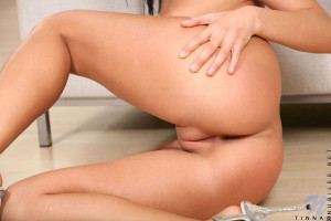 Enticing gorgeous nubile with hot plump ass enjoys flaunting her irresistible tight pussy
