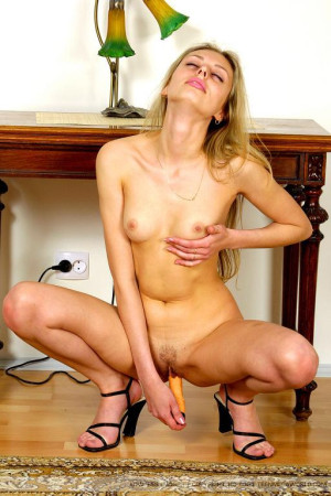 Teen model plays with a dildo
