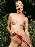 Fresh faced angel strips and finger shaved pussy outdoors