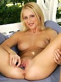 Heavenly blonde strips and dildos pussy and asshole outdoors