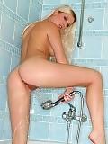 Stunning blonde nudes and sprays shaved pink snatch in bath