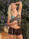 Buxom blonde bombshell strips and spreads hot pussy outdoors