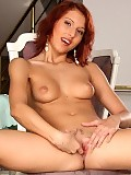 Slender redhead strips fingers and dildos trimmed pussy
