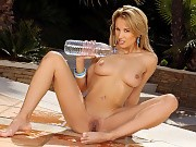 Sizzling vixen spreads and fucks large water bottle on patio