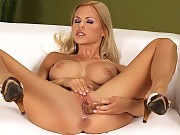 Busty blonde undresses fingers and dildos tight shaved pussy