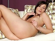 Leggy brunette honey strips and dildos moist pussy on sofa