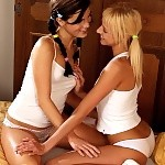 Stunning teen cuties get naked kiss and fist juicy pussies