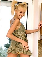 Blonde nymph strips and dildos her tight pink quim indoors