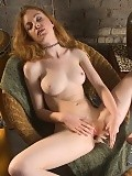 Luscious redhead bangs big massage tool and dildo in chair