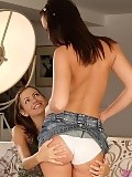 Enticing brunettes lap butts and dildo pussies on couch