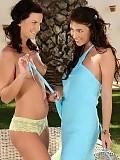 Stunning brunettes undress and dildo assholes in garden