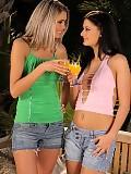 Dazzling vixens strip kiss and rub smooth twats outside