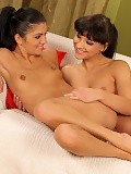 Stunning brunettes strip and finger sweet pussies in bed