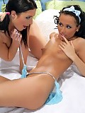 Stunning brunettes lap and finger tight buttholes in bed